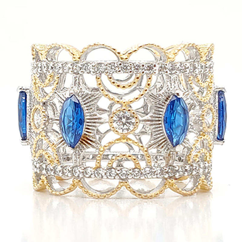 Royal crown type ring with blue gemstone