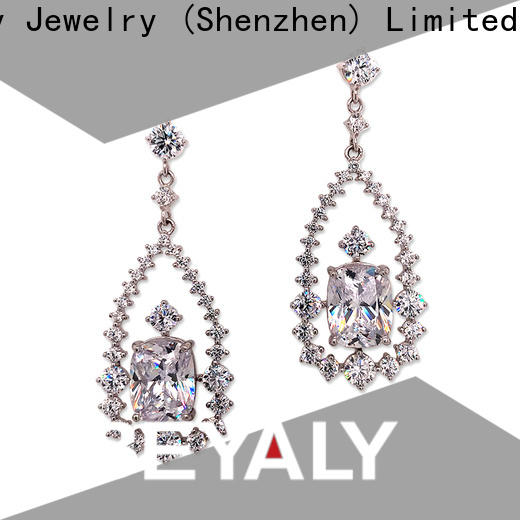 BEYALY flower white gold and diamond stud earrings for women