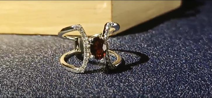 Symmetrical curved shape red zircon silver ring