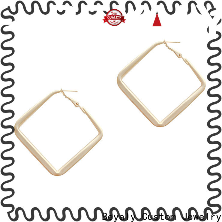 Wholesale gold hanging earrings with price design factory for women