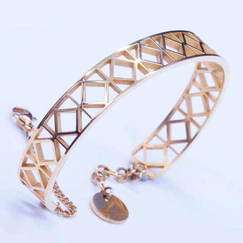 Gold-tone stainless steel hollow out plaid bangle design